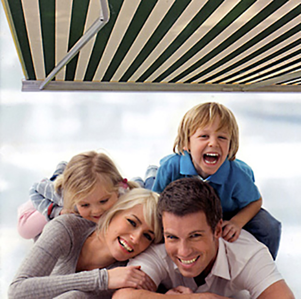 Family in the shade of a retractable awning